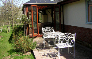 Conservatory and outside seating area.